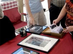 Customers look through Matthew Barnes' photographs