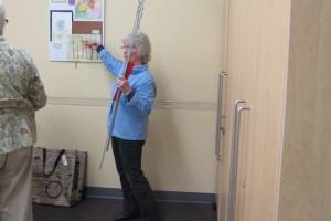 Carol Heikema installing her student's show
