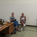 Judi Brook and a volunteer in the old auditorium.
